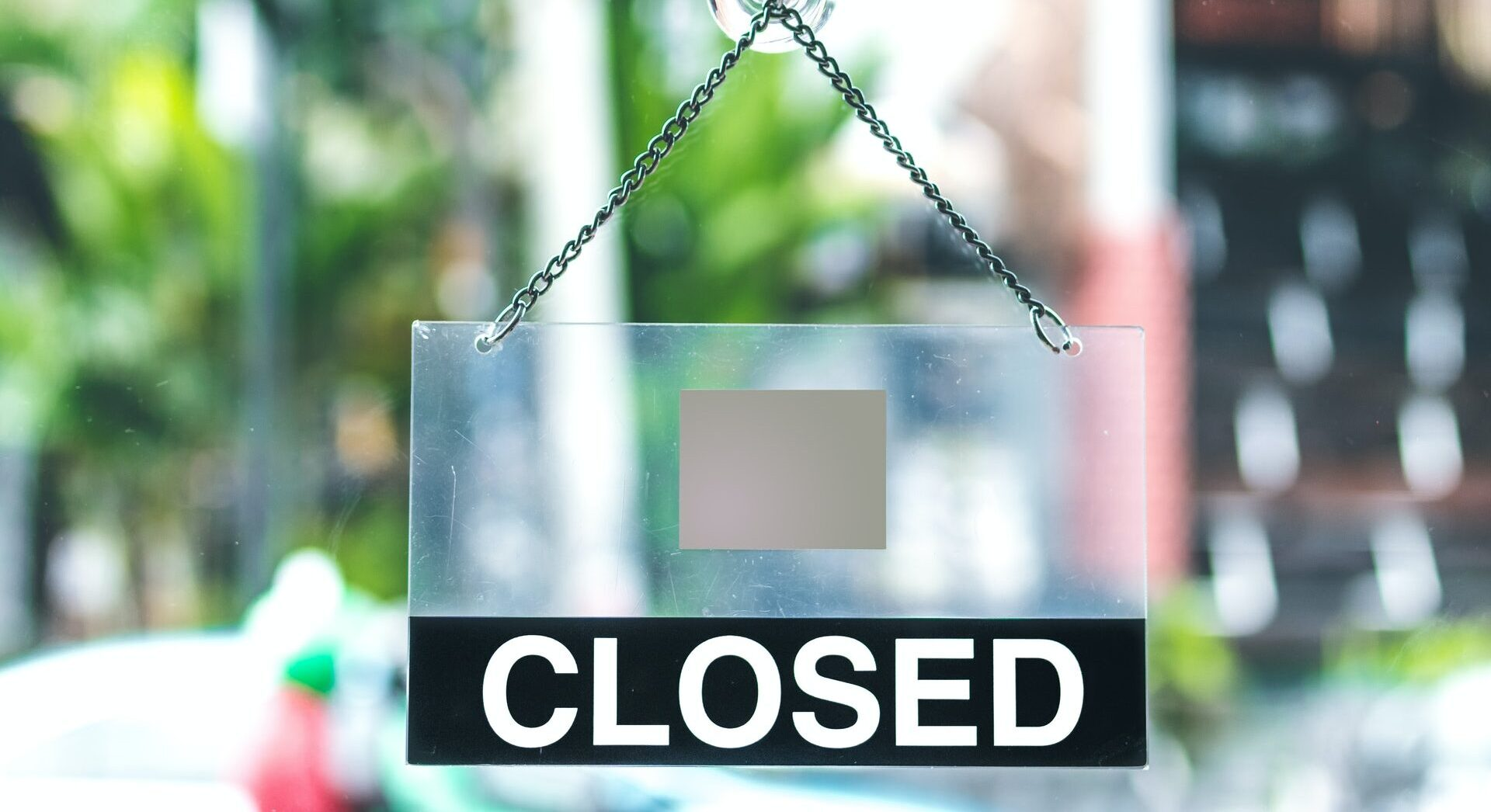 "A sign on a business that says ""Closed.""  business interruption helps cover costs so that you can go back to running your business"